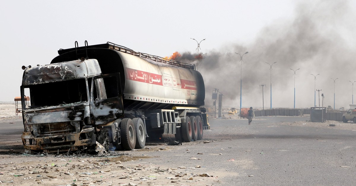 Smoke rises from an oil tanker truck set ablaze during clashes between southern separatist fighters and government forces, Aden, Aug. 29, 2019.