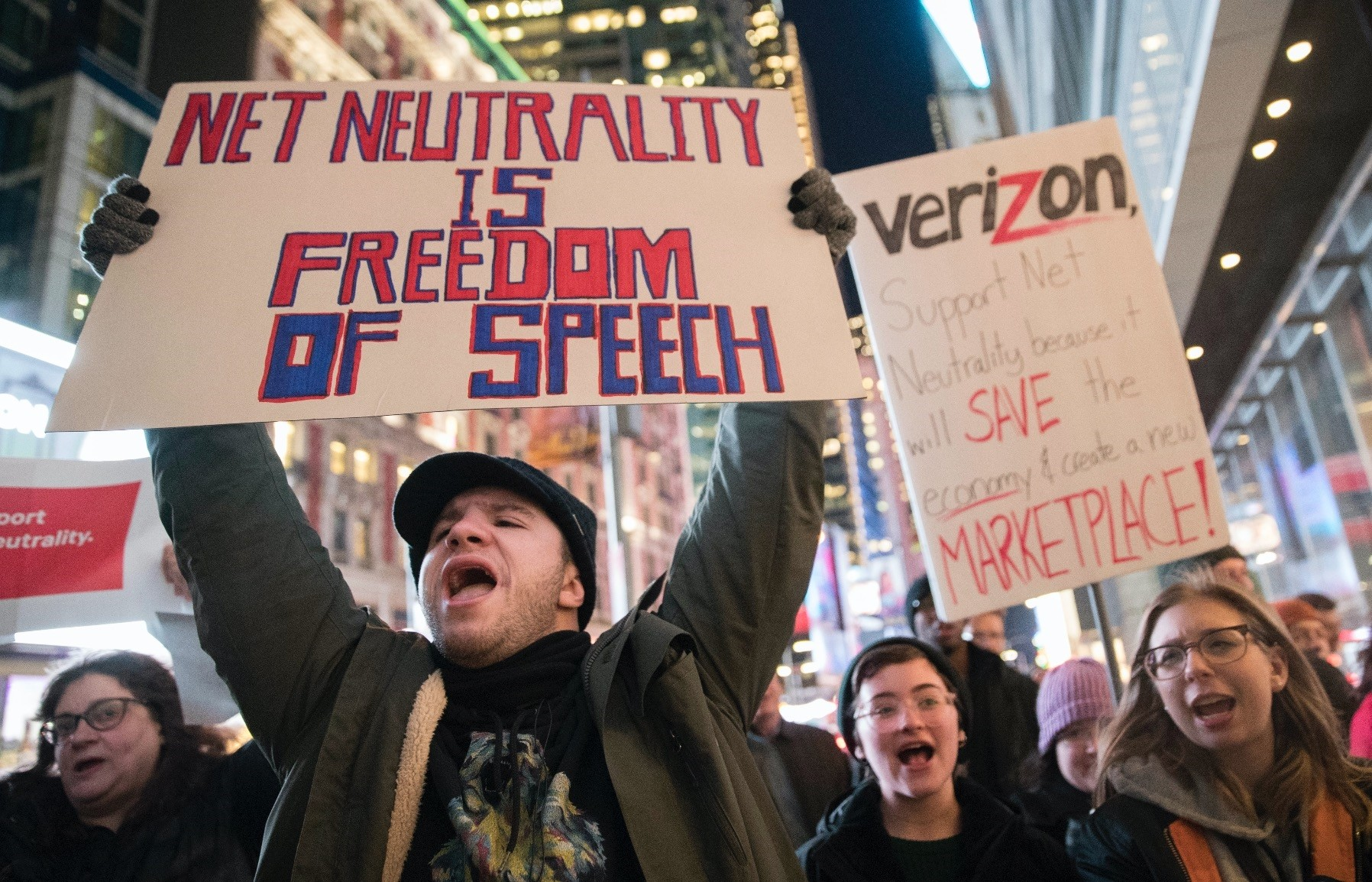 Demonstrators rally in support of net neutrality outside a Verizon store in New York on Dec. 7, 2017.
