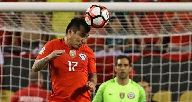 Gary Medel of Chile heads the ball