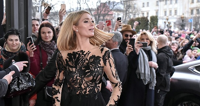 US model, businesswoman and socialite Paris Hilton (C) arrives to the Grand Hotel in Lviv, Western Ukraine, March 31, 2018. (EPA Photo)
