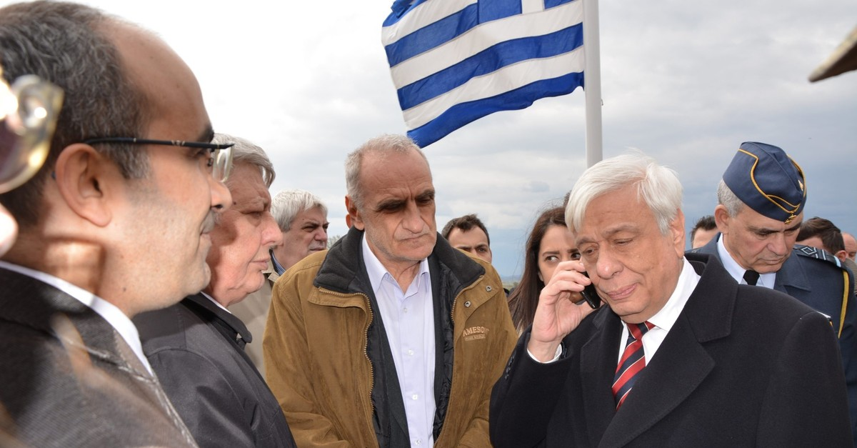 Greek President Prokopis Pavlopoulos speaks with Turkish President Recep Tayyip Erdou011fan on the phone during a visit to Greek soldiers on the Greece-Turkey border in this undated photo. (AA File Photo)