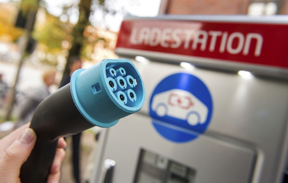 A plug is shown at a charging station for electric vehicles in Hamburg, Germany.