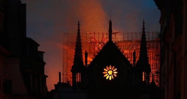 Flames and smoke rise from Notre Dame cathedral as it burns in Paris, Monday, April 15, 2019. (AP Photo)
