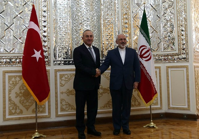 This file photo dated Dec. 17, 2014, shows Turkish FM Mevlüt Çavuşoğlu is being greeted by his Iranian counterpart Javad Zarif at the Foreign Ministry in Tehran, Iran. (AA Photo)