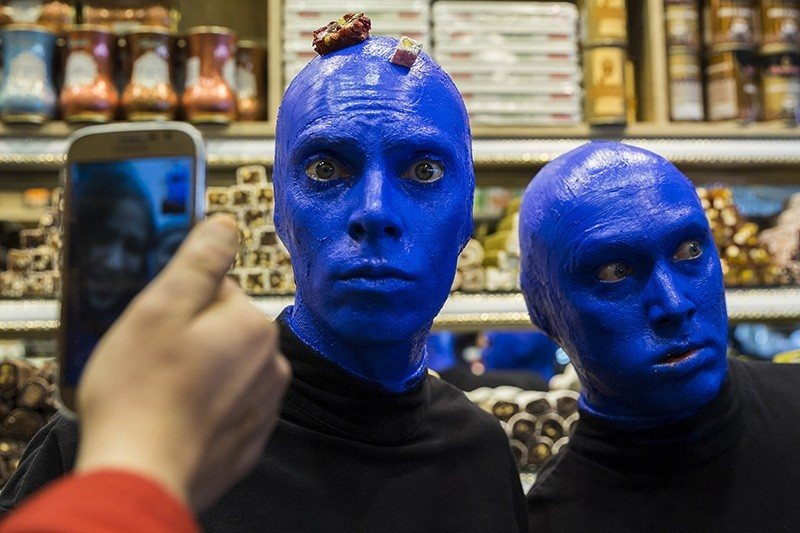 Blue Man Group snaps selfies with locals