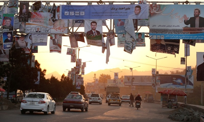 Campaign posters of candidates for the upcoming parliamentary election are installed on a light pole in downtown Kabul, Afghanistan, 06 October 2018. (EPA Photo)