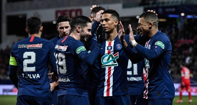 PSG players celebrate a goal during a French Cup match in Dijon, Feb. 12, 2020. AFP Photo