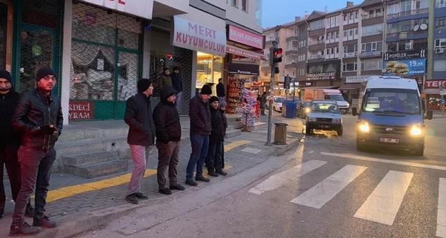 People wait outside after the magnitude 4.2 earthquake in Ankara AA Photo
