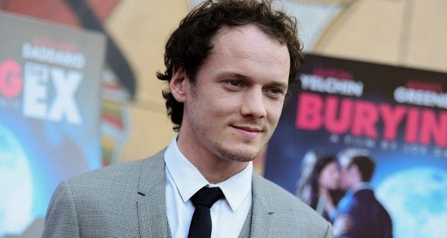 Anton Yelchin arrives at a special screening of Burying the Ex held at Grauman's Egyptian Theatre in Los Angeles. (AP PHOTO)