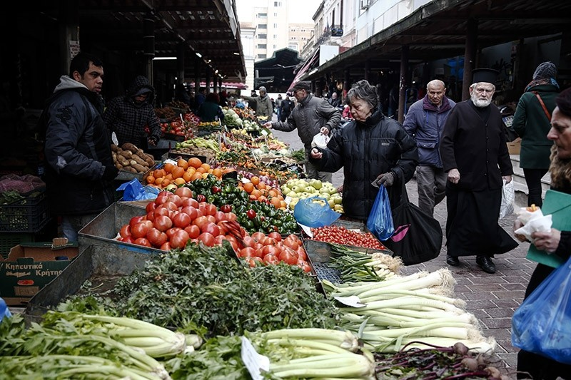 Consumers buy groceries at a main food market of Athens on Thursday, Jan. 26, 2017. (AP Photo)