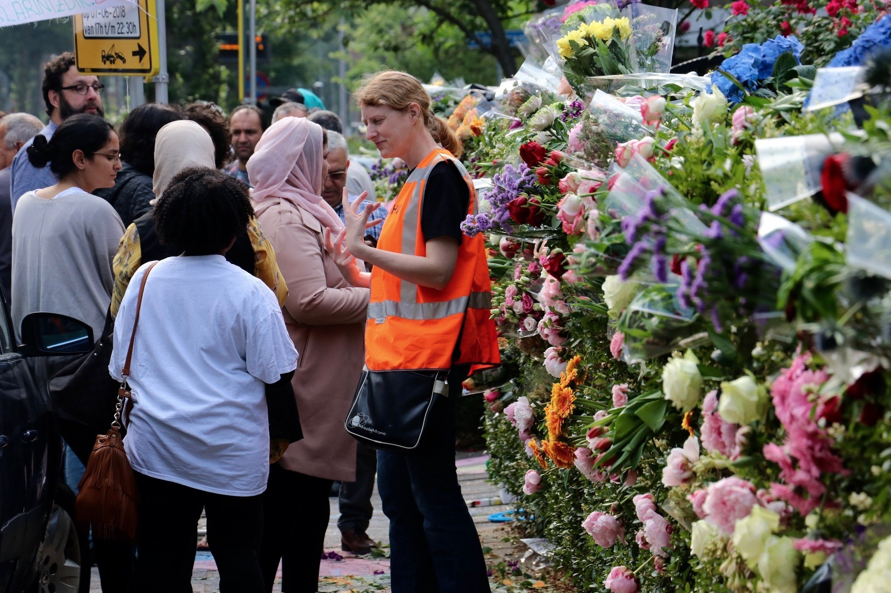 People leave flowers at the entrance of the Turkish mosque, Rotterdam to protest the anti-Islamic Pediga groupu2019s plan to roast pork in front of it during the fast-breaking meal, June 7.