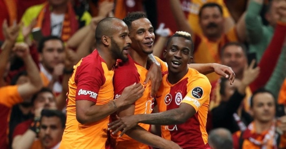 Onyekuru (R) and Fernando, who scored Galatasarayu2019s two goals in the derby, join Marcao (L) for celebration.