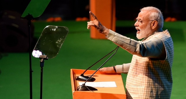 Indian Prime Minister Narendra Modi gestures as he speaks during a traders national convention in New Delhi on April 19, 2019. (AFP Photo)
