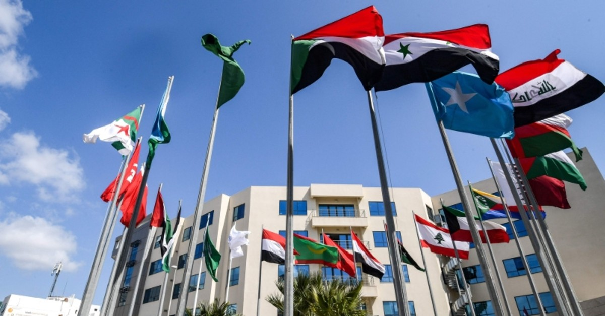 This picture taken on March 28, 2019 shows the flags of the Arab League member states flying outside the Council of Arab Interior Ministers' headquarters in the Tunisian capital Tunis, ahead of the summit due to take place on March 31. (AFP Photo)