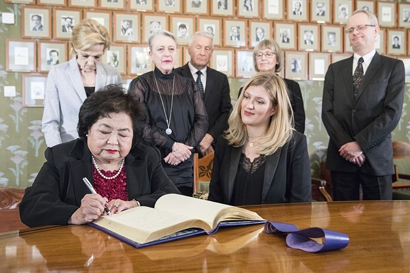 ICAN campaigner and Hiroshima survivor, Setsuko Thurlow signs the Nobel protocol, during a press conference at the Norwegian Nobel Committee, in Oslo, Norway, Dec. 9, 2017. (AP Photo)