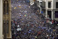 At least 160,000 protesters marched Saturday in Barcelona to demand that Spain's conservative-led government increase its efforts to take in refugees from war-torn countries like Syria.
