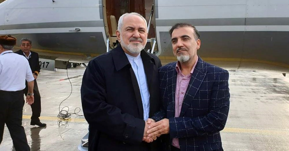 A handout picture on the Iranian Foreign Minister's official Twitter account on Dec. 7, 2019, shows Foreign Minister Mohammad Javad Zarif (L) and Iranian scientist Massoud Soleimani standing by a plane at an undisclosed location. (AFP Photo)