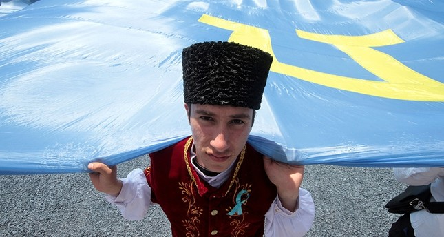 People gather to commemorate the anniversary of the deportation of Crimean Tatars from Crimea to Central Asia in 1944, in Bakhchysarai district of Crimea, May 18, 2016 (Reuters Photo)