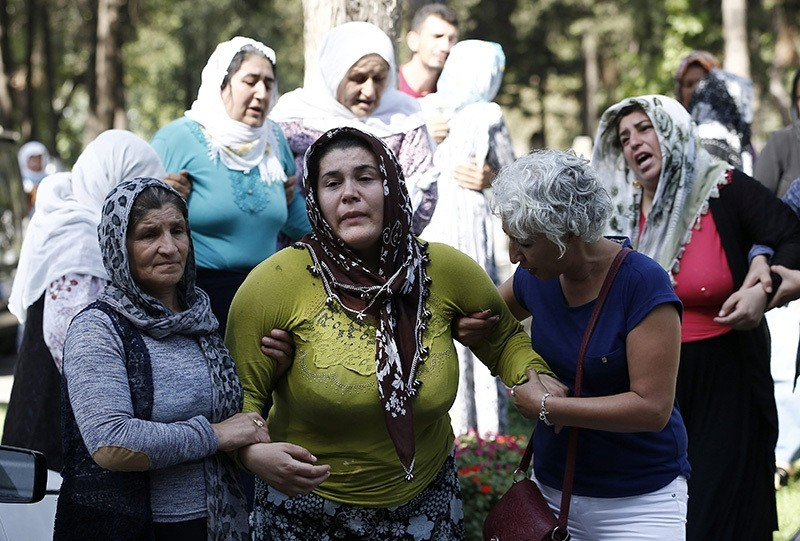 Emine Ayhan (C) lost four of her five children in the attack (EPA Photo)