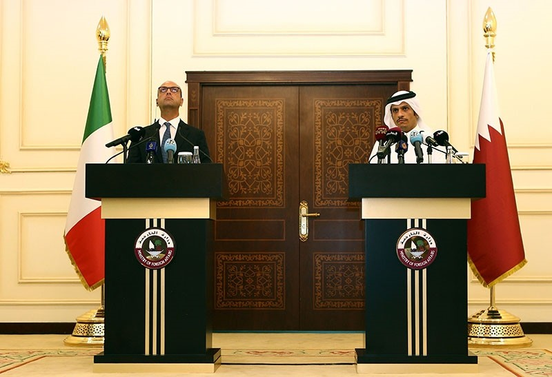 Qatari Foreign Minister Sheikh Mohammed bin Abdulrahman Al-Thani (R) and his Italian counterpart Angelino Alfano speak during a press conference in Doha on August 2, 2017. (AFP Photo)
