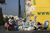 Greece's government is urging striking garbage collectors to return to work after a 10-day protest has left huge piles of trash around Athens and a heat wave is expected to hit later this...
