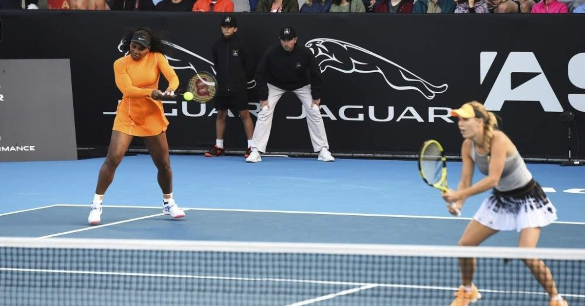 Serena Williams (L) and Caroline Wozniacki (R) in action in the match against the Japanese team, Auckland, Jan. 6, 2020. (AP Photo)