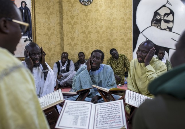 Senegalese migrants recite hymns in a religious ritual in Istanbul. The city is home to a large expat population from African countries.