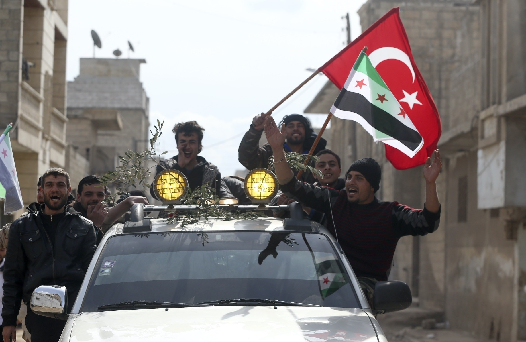 Arabs in the Syrian city of Azaz show support for the Turkish military and Free Syrian Armyu2019s Operation Olive Branch with a convoy, Feb. 14, 2018.