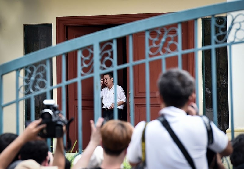 An unidentifed man opens the door of the North Korean embassy in Kuala Lumpur on March 5, 2017. (AFP Photo)