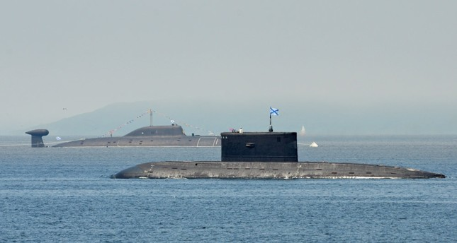 Submarines sail during a rehearsal. Turkey will export engineering services in submarine modernization, an area which requires high technology.