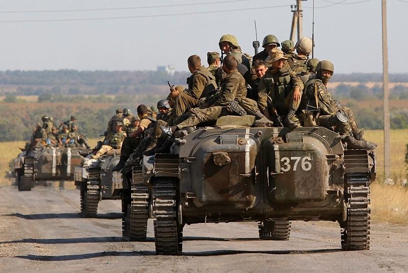 Ukrainian troops evacuated from the separatist-held town of Starobesheve, eastern Ukraine, Aug. 30, 2014. (AP Photo)