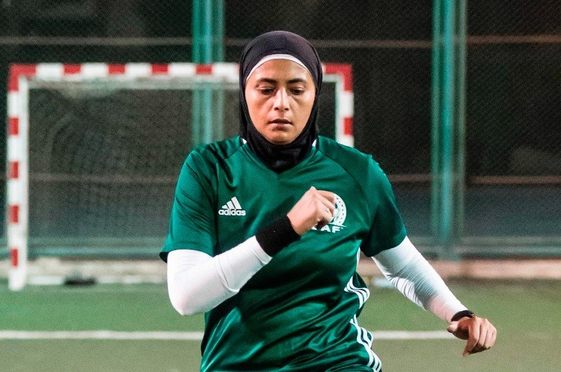 Egyptian referee Hanan Hassan warms up prior to a womenu2019s football match in Cairo, June 3.