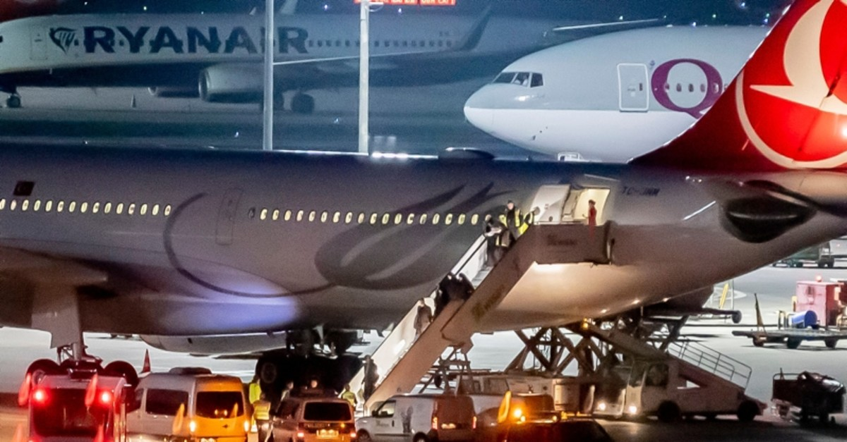In this Thursday, Nov. 14, 2019 photo people leave an airplaine of the airline 'Turkish Airline' at the airport Tegel in Berlin, Germany (AP Photo)