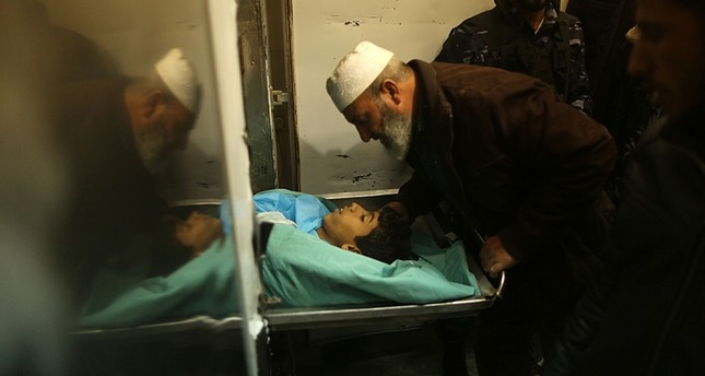 A relative mourns over the body of 15-year-old Palestinian Amir Abu Musaid, in the central Gaza Strip, after he was shot dead in clashes with the Israeli military along the Gaza border, Jan. 11, 2018.  (AFP Photo)
