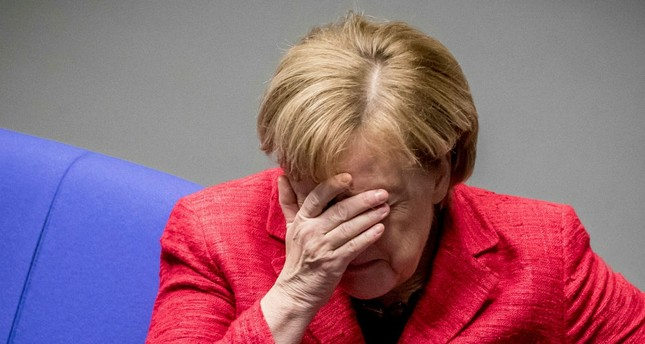 Merkel battles to stay in power, calls for new elections