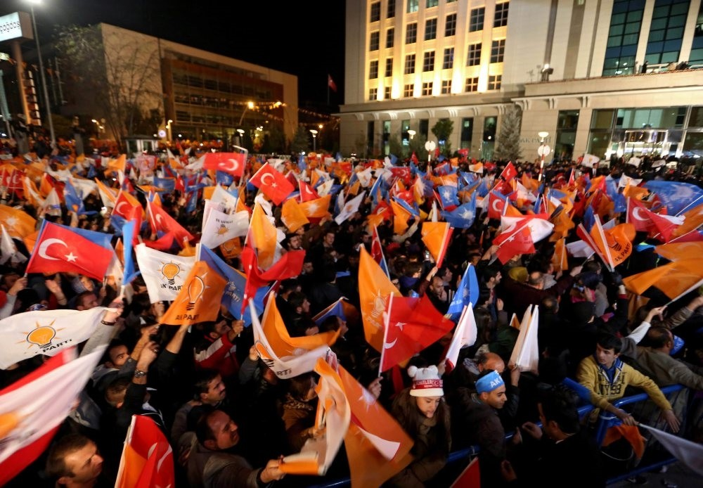 AK Party supporters celebrate after hearing the early results of the elections in front of the party headquarters in Ankara, Nov. 1, 2015.