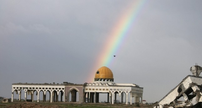 This Jan. 2, 2016 photo shows a rainbow over the former Gaza international airport that was destroyed by Israeli airstrikes, during a rainy day in Gaza. (Reuters Photo)