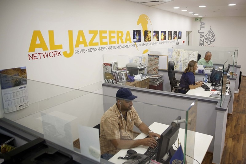 In this photo Al-Jazeera TV employees are shown working at the broadcaster's Jerusalem office, July 29, 2017. (AA Photo)