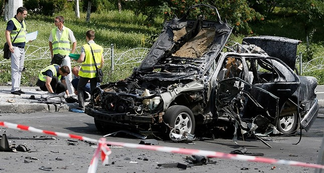 Investigators work at the scene of a car bomb explosion which killed Maxim Shapoval, a high-ranking official involved in military intelligence, in Kiev, Ukraine, June 27, 2017 (Reuters Photo)