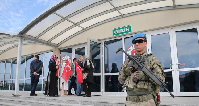 A soldier stands guard outside the courtroom as families of those killed by putschists enter the courtroom for Istanbul's main coup trial.