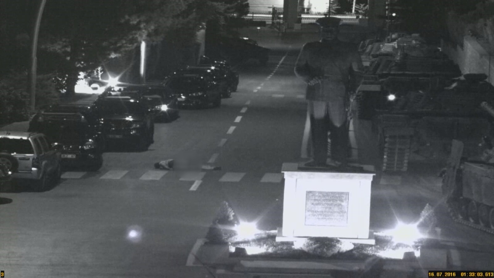 A surveillance camera image shows a victimu2019s body lying on the ground after the soldiers dumped it from a military vehicle.