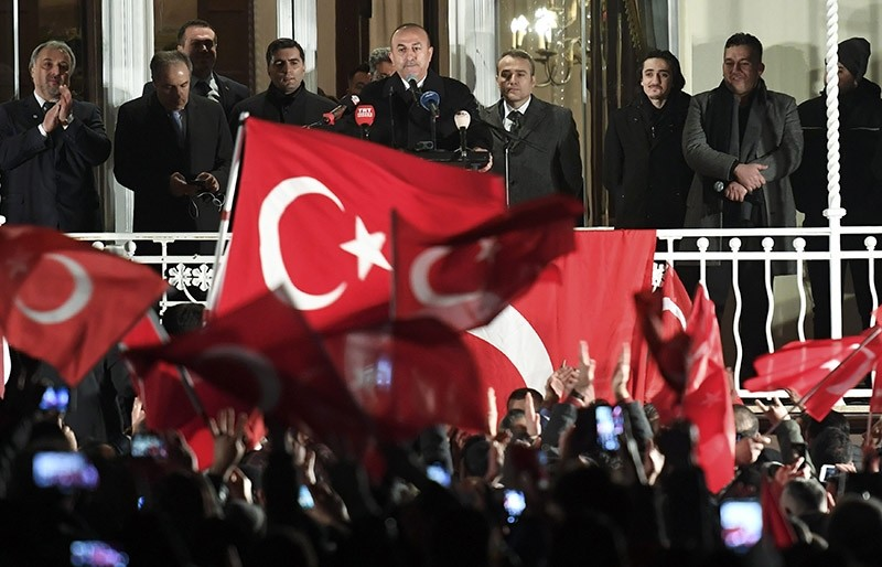 Foreign Minister Mevlut Cavusoglu speaks from a balcony during an election campaign rally for the upcoming Turkish referendum in Hamburg, Germany March 7, 2017. (Reuters Photo)