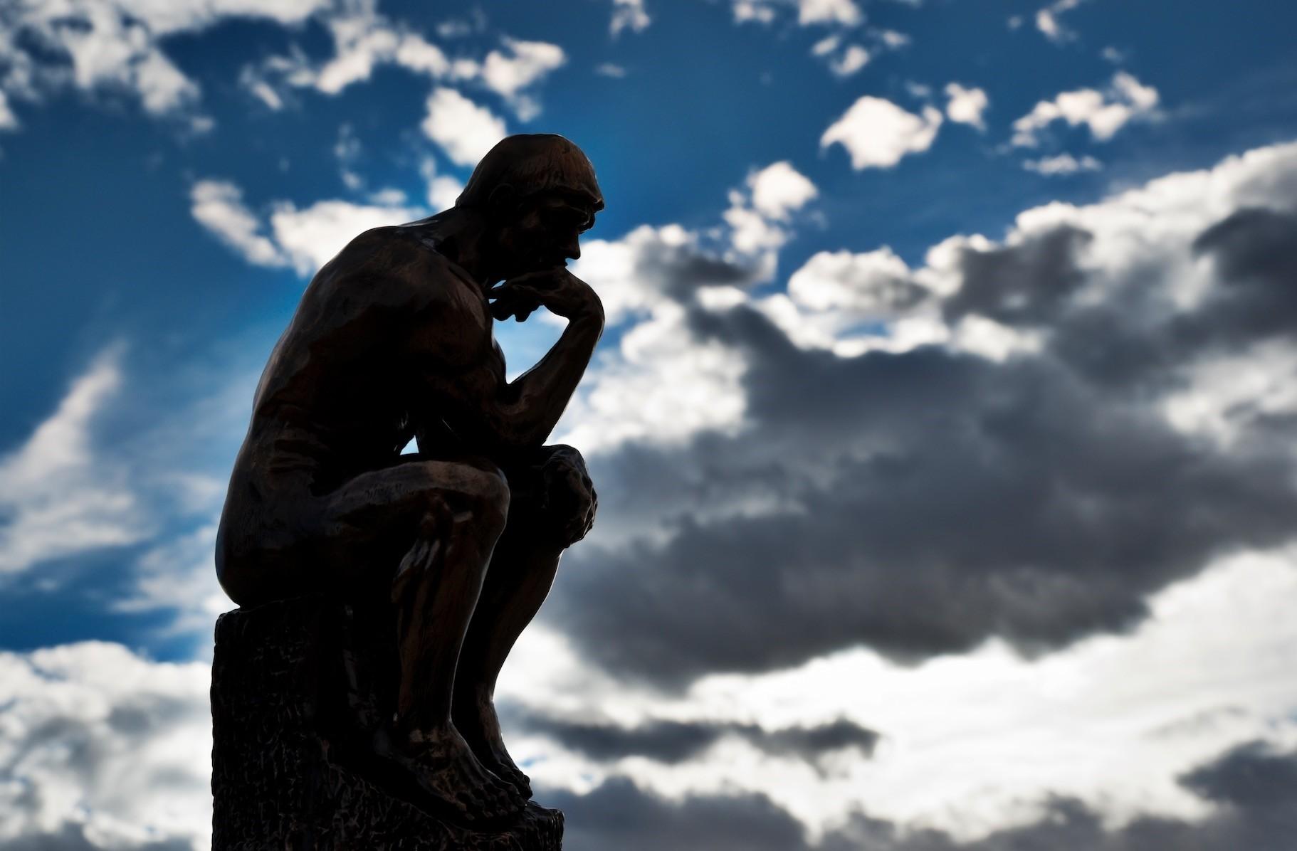 u201cThe Thinker,u201d a bronze sculpture by Auguste Rodin.