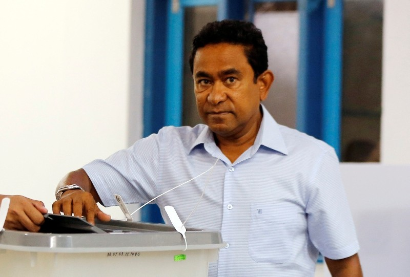 In this Sunday, Sept. 23, 2018, file photo. Maldivian President Yameen Abdul Gayoom casts his vote at a polling station during presidential election day in Male, Maldives. (AP Photo)