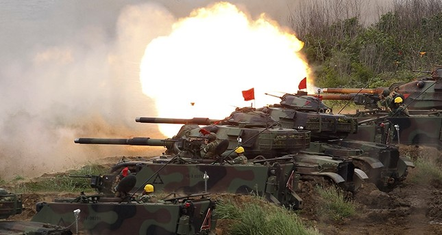 In this Tuesday, May 25, 2017, file photo, a line of U.S. M60A3 Patton tank fire at targets during the annual Han Kuang exercises on the outlying Penghu Island, Taiwan (AP Photo)