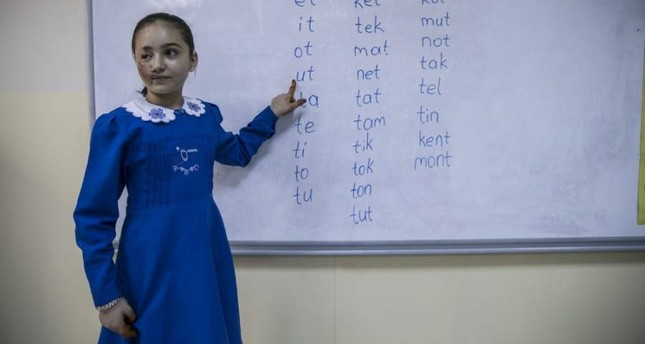 Lujain Kifretune attends a school in Hatay, where she arrived with her family 11 months ago. (AA Photo)