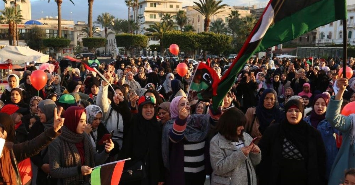 Libyan people in the capital Tripoli welcome the announcement of a cease-fire, Jan. 10, 2020. (AA)