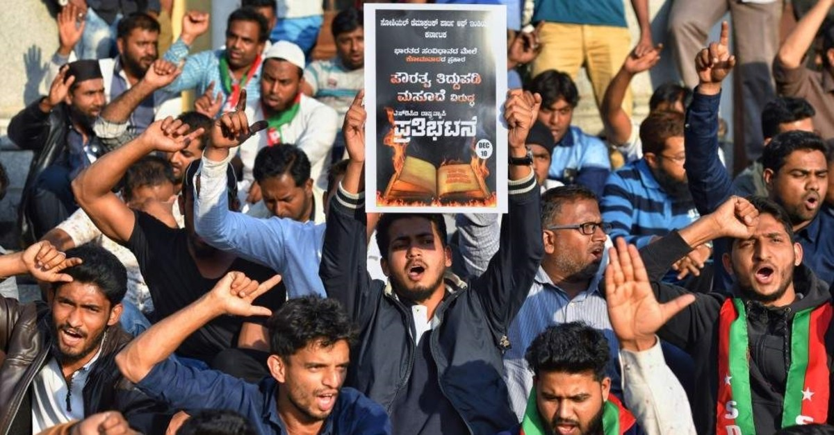 Members and activists of Social Democratic Party of India (SDPI) hold posters and shout slogans against the Citizenship Amendment Bill 2019 during a protest demonstration in Bangalore, Dec. 10, 2019. (AFP Photo)