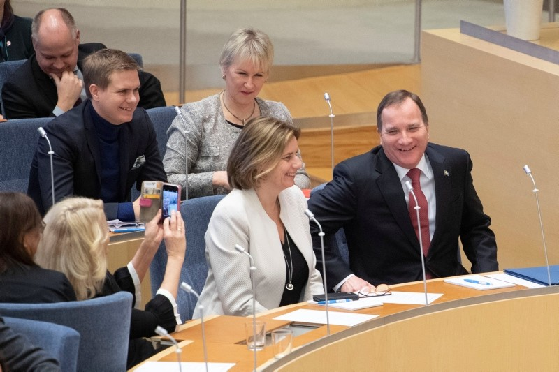 Social Democrat leader Stefan Lofven (front R) sits next to Green Party co-leader Isabella Lovin after being voted back as prime minister, in Stockholm, Sweden January 18, 2019. (TT News Agency/Jessica Gow/via Reuters)