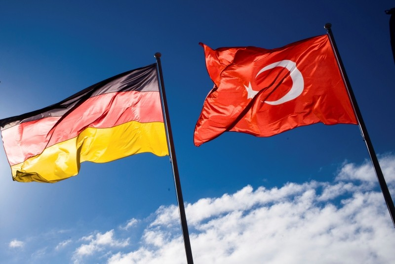 A German and Turkish flag wave at the airport Tegel prior to the arrival of Turkey's President Recep Tayyip Erdogan for an official state visit in Germany at the capital Berlin, Thursday, Sept. 27, 2018. (AP Photo)